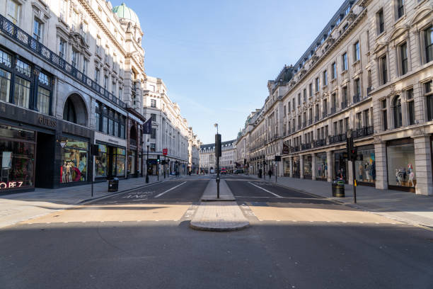 Empty Regent street at rush hour during lockdown London, UK - March 25th 2020: Deserted shopping district during coronavirus crisis central london stock pictures, royalty-free photos & images