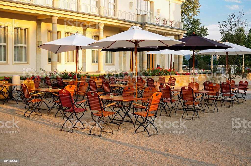 Empty restaurant chairs and tables stock photo