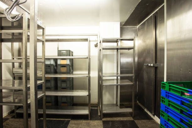 empty restaurant kitchen storage room stainless steel - musica industrial foto e immagini stock