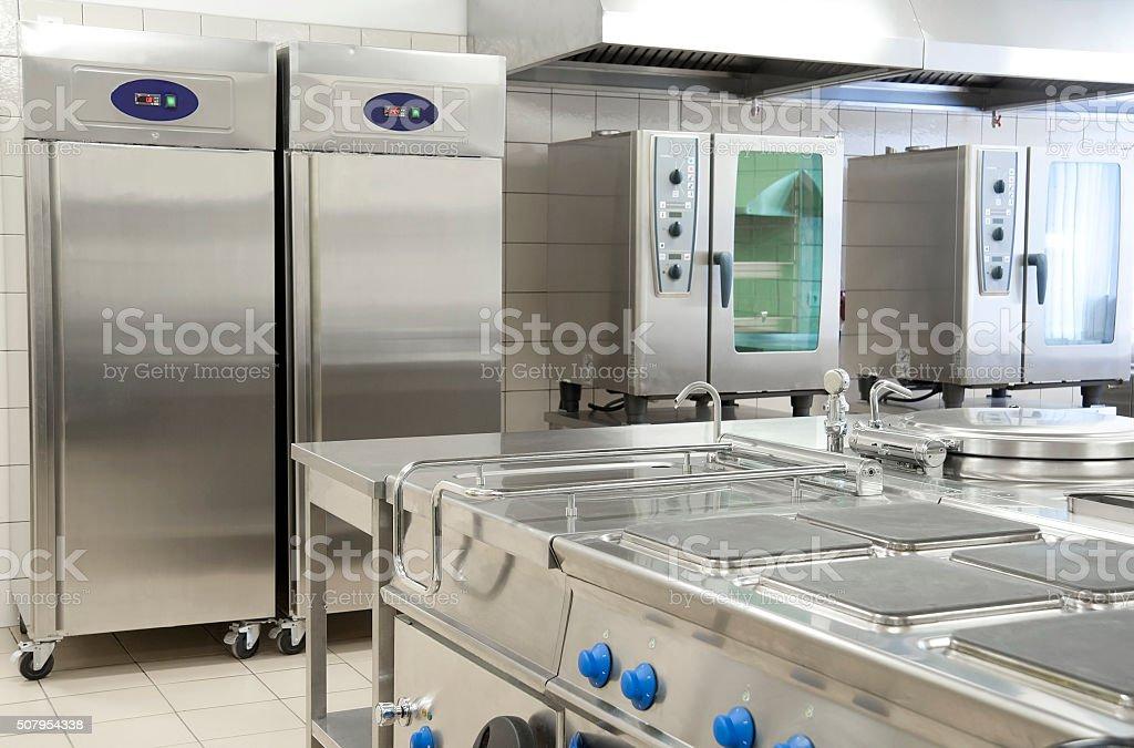 Empty Restaurant Kitchen With Professional Equipment Stock Photo - Restaurant kitchen equipment