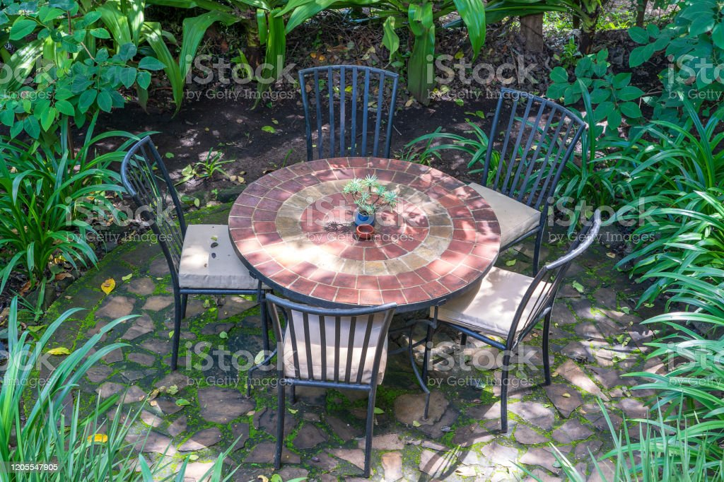 Empty Restaurant Terrace In Tropical Garden With Tables And Chairs Tanzania Africa Stock Photo Download Image Now Istock
