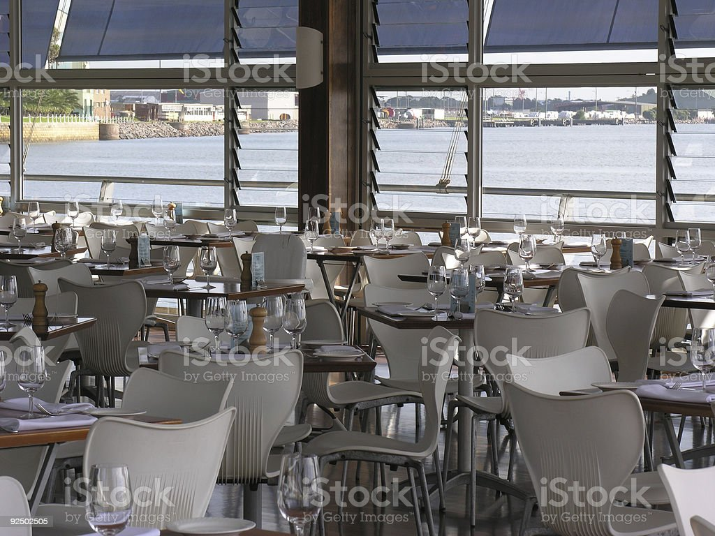Empty restaurant with water view royalty-free stock photo