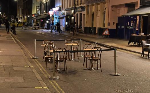 Empty restaurants and street in Soho, London, night-time