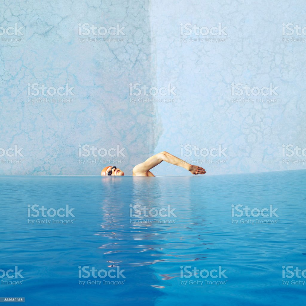 Empty retro swimming pool with woman swimming in mid air.