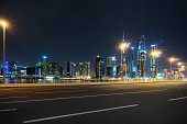 night scene of busy traffic on road in midtown of dubai