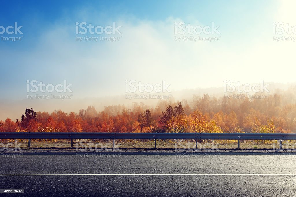 A empty road during sunset time on autumn stock photo