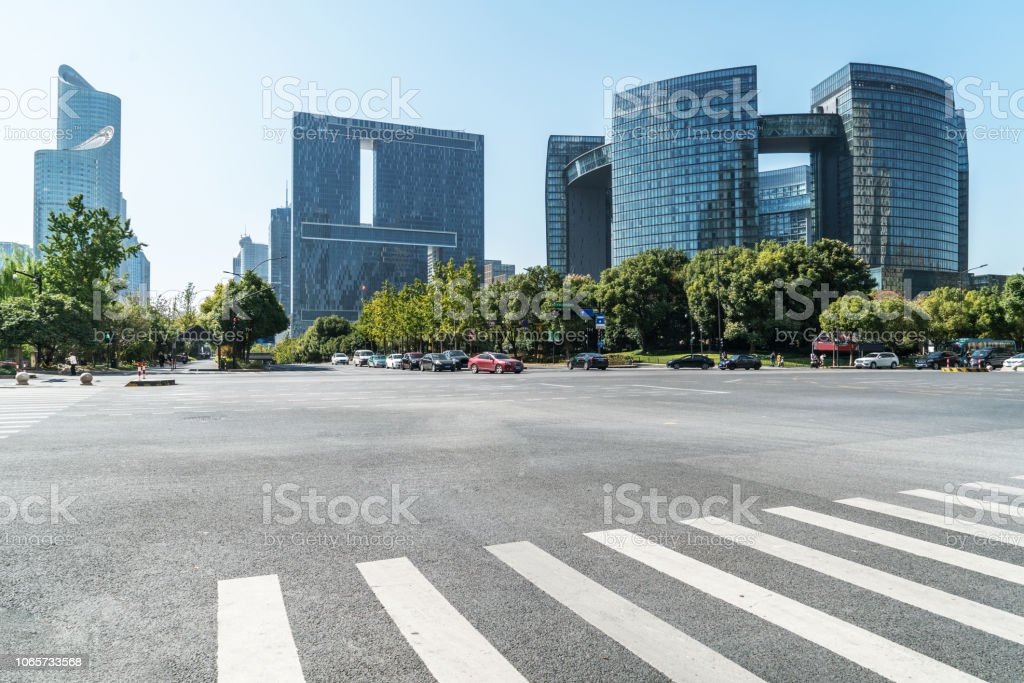 Empty road floor surface with modern city landmark buildings of hangzhou bund Skyline,zhejiang,china stock photo