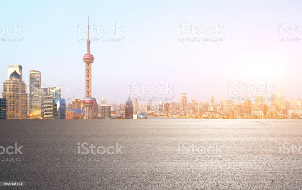 Empty road floor surface with modern city landmark buildings of Shanghai bund Skyline royalty-free stock photo