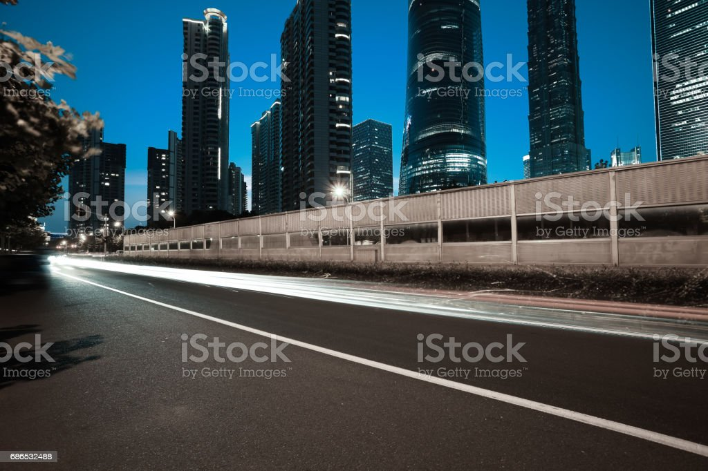 Empty road floor surface with modern city landmark buildings of night scene in Shanghai zbiór zdjęć royalty-free