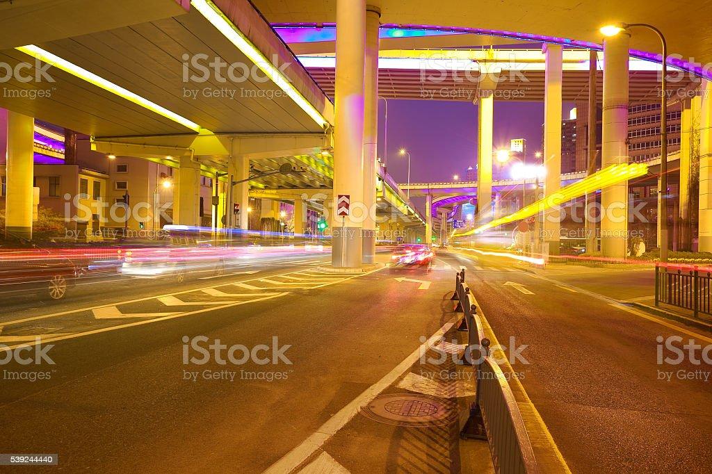 Empty road floor with city elevated bridge of night royalty-free stock photo