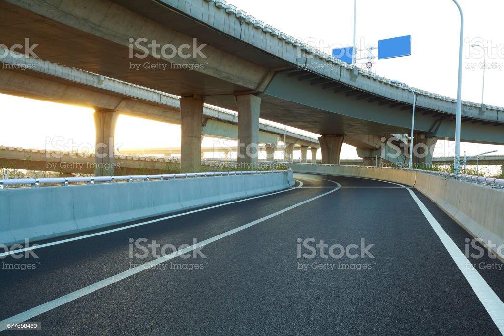 Empty road floor with city overpass viaduct bridge royalty-free stock photo