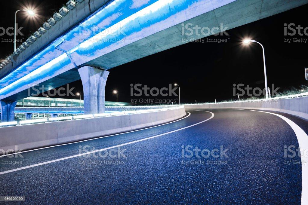 Empty road floor with city overpass viaduct bridge royaltyfri bildbanksbilder