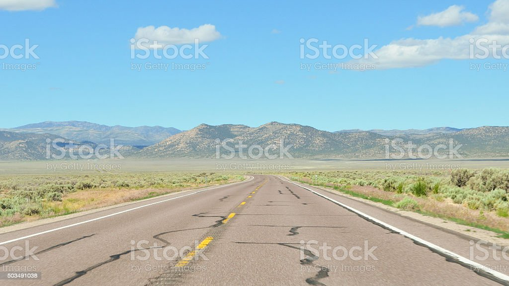 empty road in desert landscape stock photo