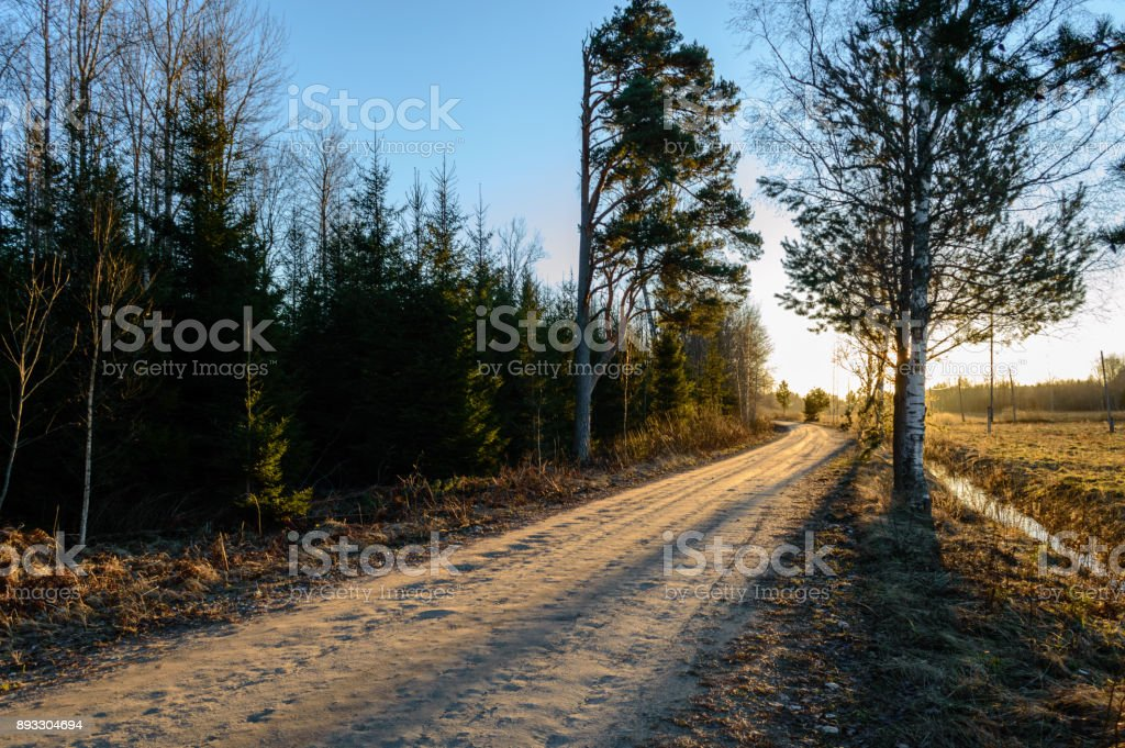empty road in the countryside in summer. gravel surface stock photo