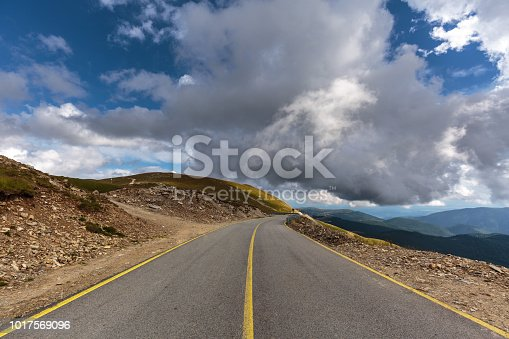Picturesque landscape with empty paved road into the mountains