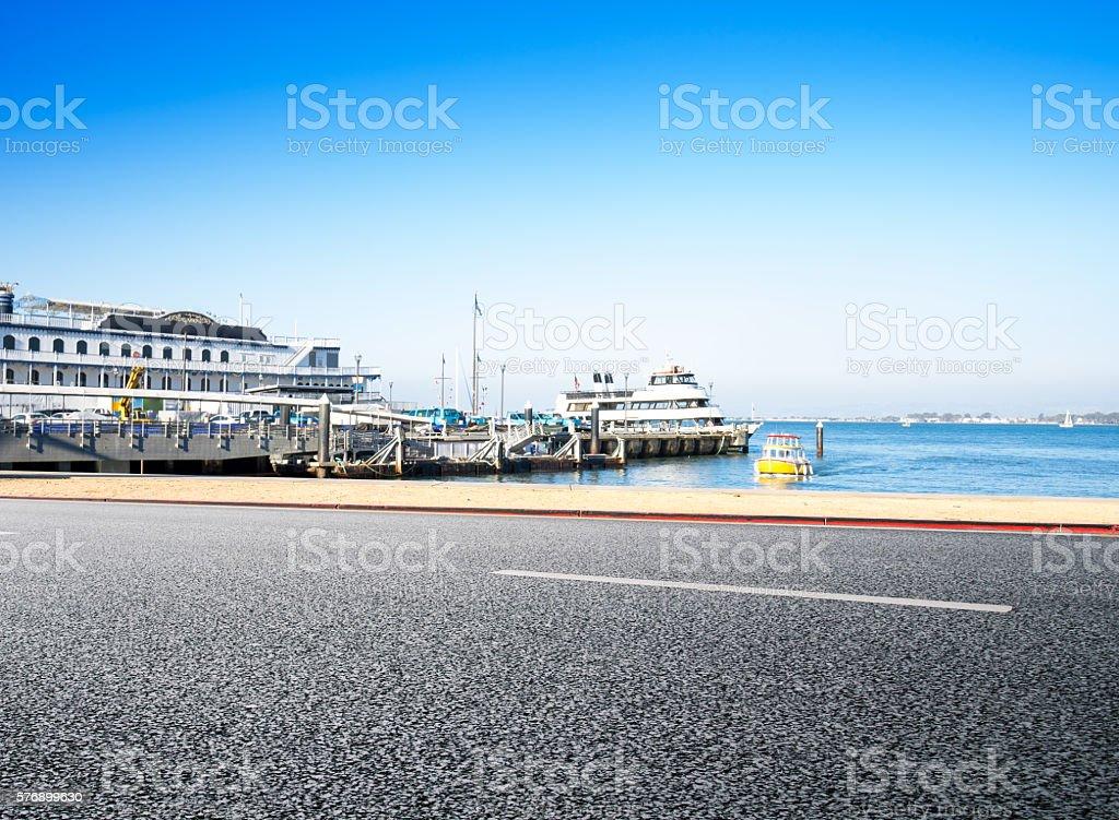 empty road near dock in san francisco in blue sky stock photo