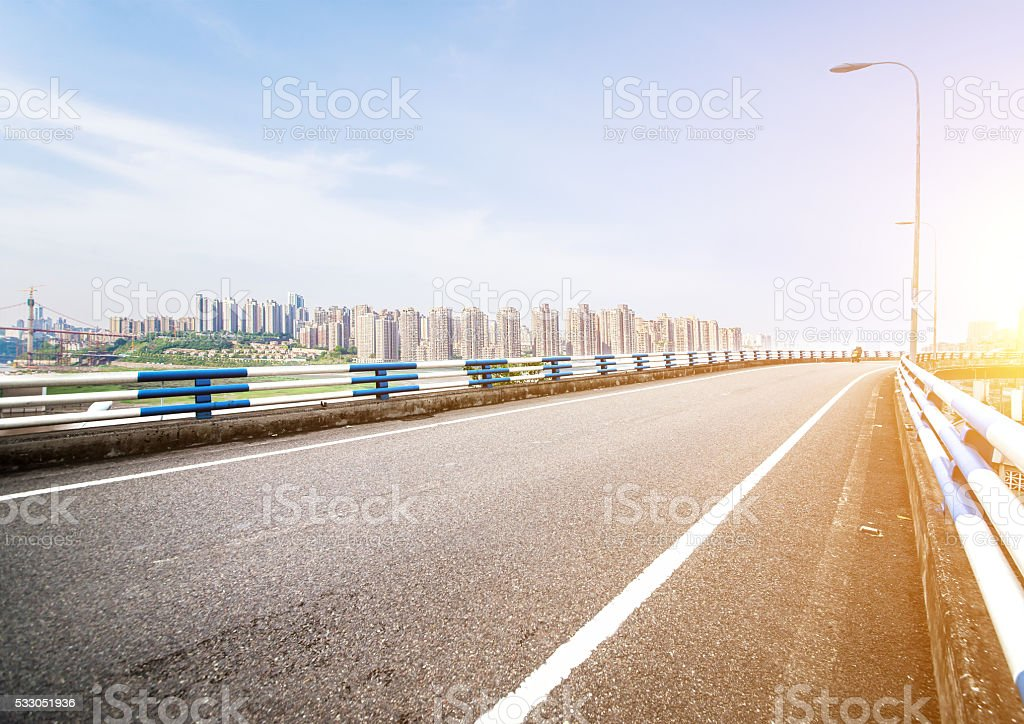 empty road near modern building stock photo