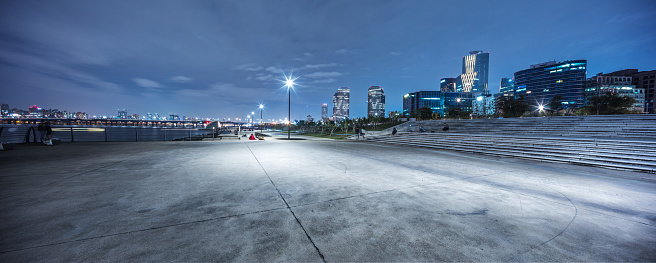 empty road near river in seoul at night