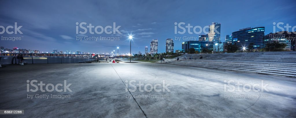 empty road near river in seoul at night stock photo