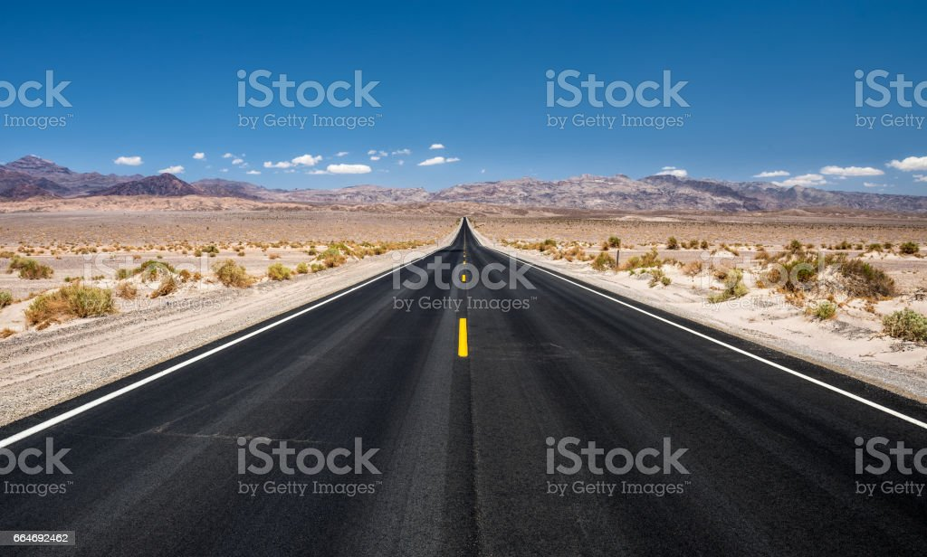 Empty road running through  Death Valley National Park stock photo