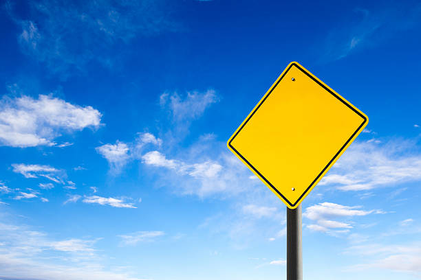 Empty Road Sign Against Blue Sky With Copy Space stock photo