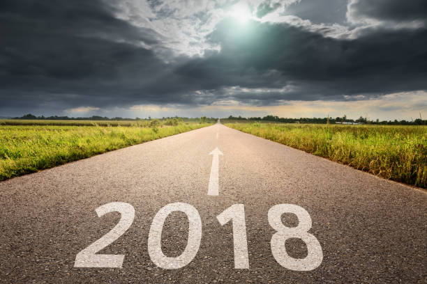 Empty road straight to upcoming and troublesome 2018 - foto de stock