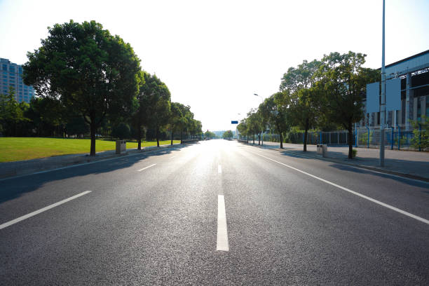 Empty road surface floor with buildings background stock photo