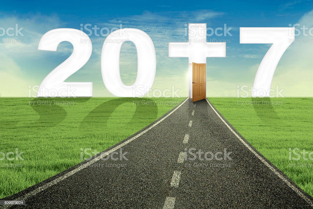 Empty road toward number 2017 with a cross foto de stock royalty-free