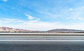 empty road travel through danxia landform,gansu province,china.