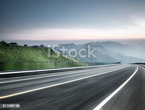 empty road travel through mountain range,China,Asia.