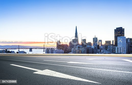 istock empty road with cityscape and skyline of san francisco sunrise 547435666