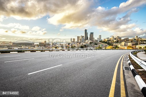 860403416istockphoto empty road with cityscape of modern city in blue sky 841744532