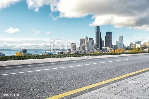860403416istockphoto empty road with cityscape of modern city 835750110