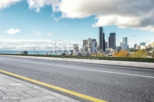 860403416istockphoto empty road with cityscape of modern city 835753844