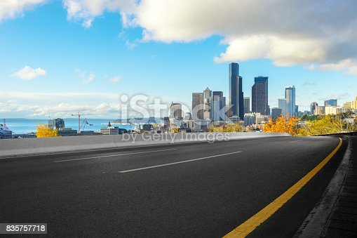 860403416istockphoto empty road with cityscape of modern city 835757718