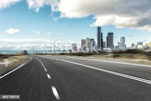 860403416istockphoto empty road with cityscape of modern city 835758018
