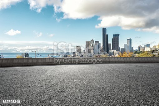 860403416istockphoto empty road with cityscape of modern city 835758348