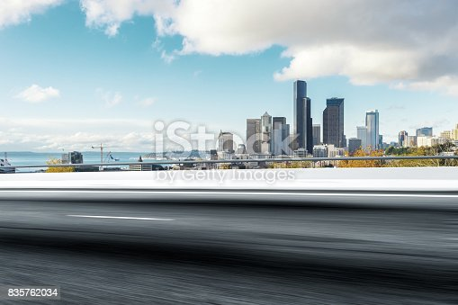 860403416istockphoto empty road with cityscape of modern city 835762034