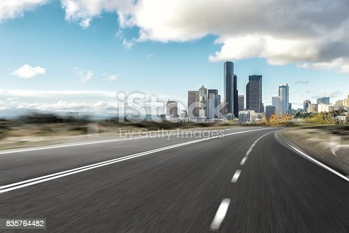 860403416istockphoto empty road with cityscape of modern city 835764482