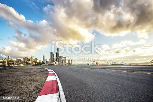 860403416istockphoto empty road with cityscape of modern city 840822028