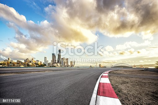 860403416istockphoto empty road with cityscape of modern city 841114130