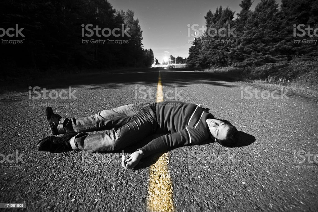 Empty Road With Dead Body in the Middle stock photo
