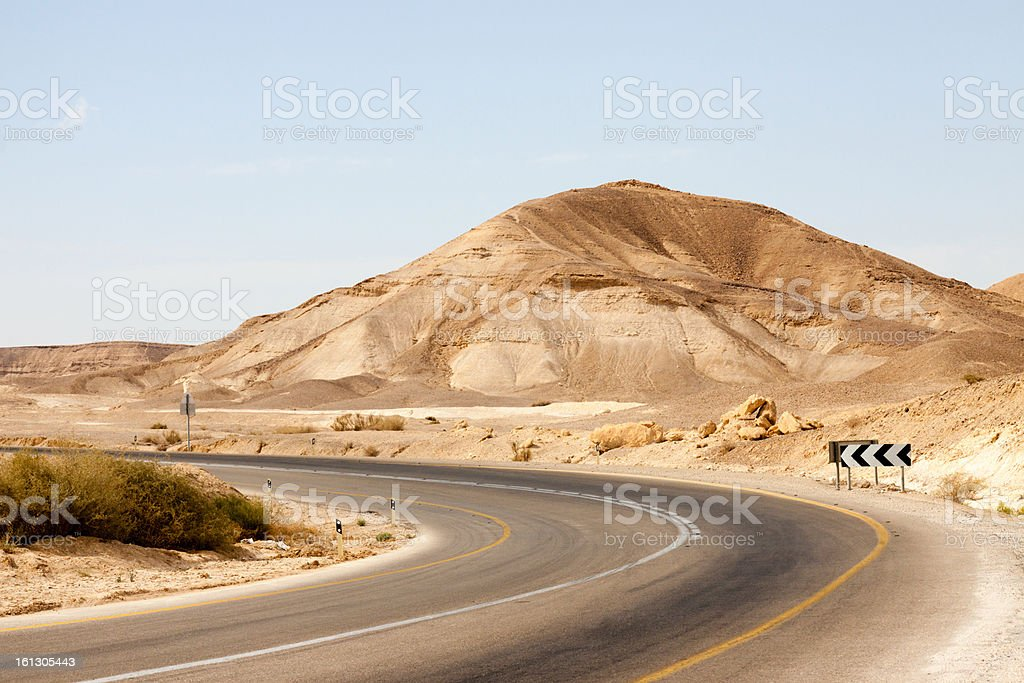 Empty road with left turn in a mountains royalty-free stock photo