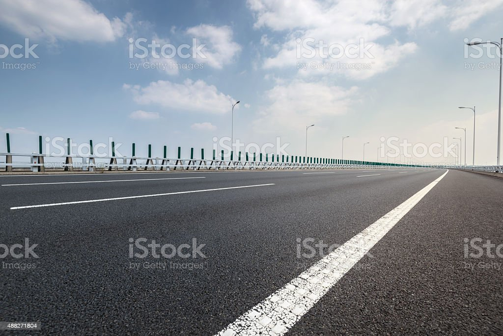 Empty road with railing stock photo