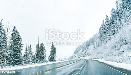 1066508460 istock photo Empty road with snow covered landscape in winter season. 504982756