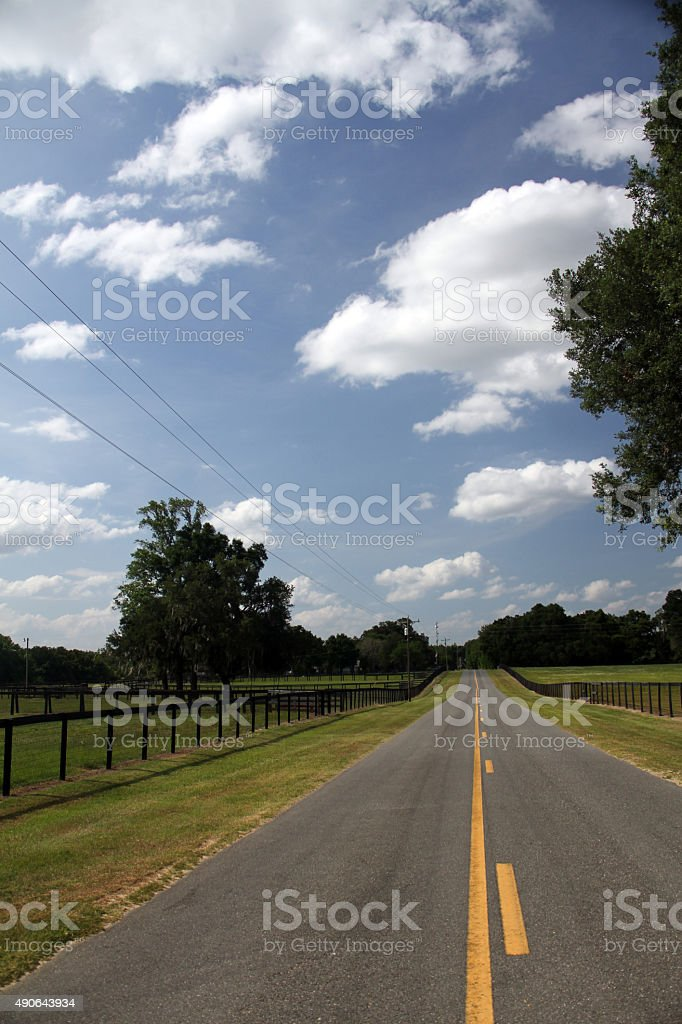Empty road with yellow lines and a beautiful sky stock photo