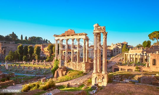 Empty Rome at dawn. Panoramic image of Roman Forum, also known as Foro di Cesare, or Forum of Caesar, in Rome, Italy, early in the morning