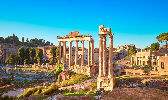 Empty Rome at dawn. Panoramic image of Roman Forum, or Foro di Cesare, or Forum of Caesar, in Rome, Italy, early in the morning