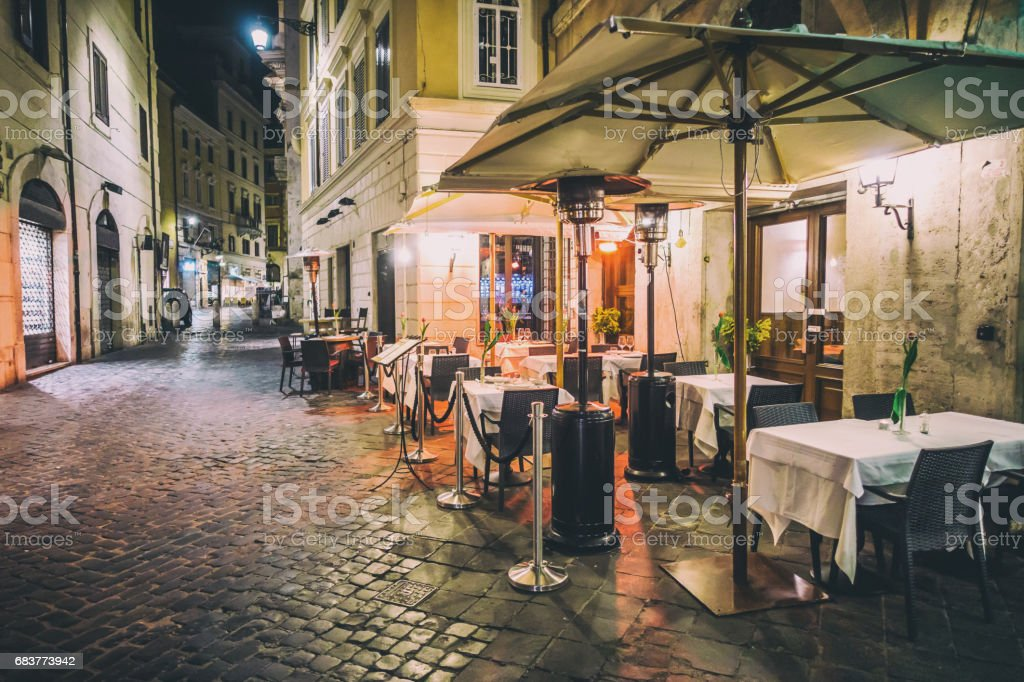 empty rome restaurant tables night decoration stock photo