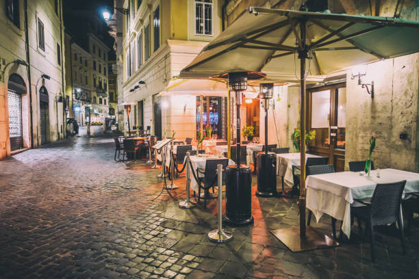 empty rome restaurant tables night decoration - pizzeria stock photos and pictures